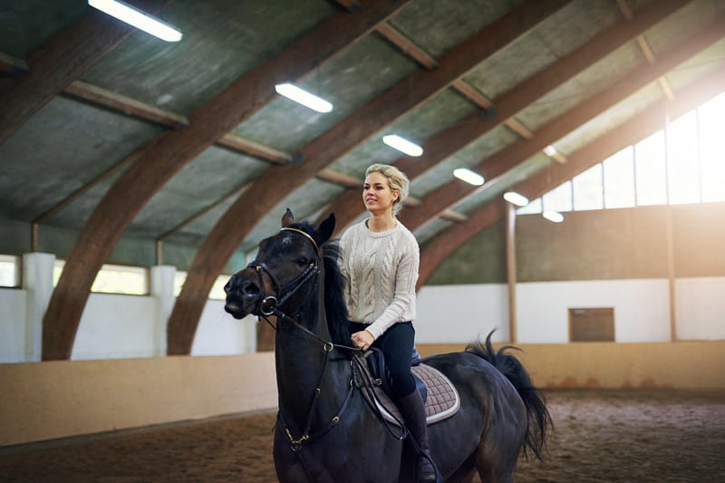 this is a picture of a woman horseback riding